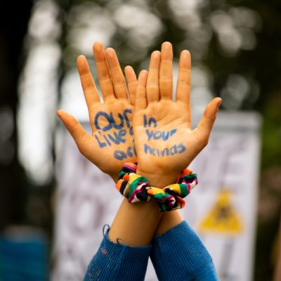 PGS Marketing Climate change protest message written on youth hands